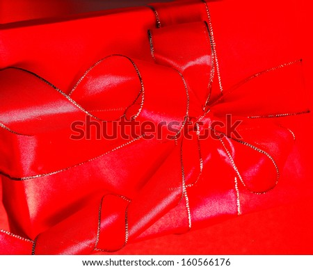 red parcel with a red ribbon - stock photo
