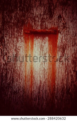Red peeling paint with stain from handle - stock photo