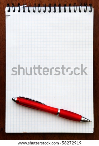 Red pen and Spiral Notebook - stock photo