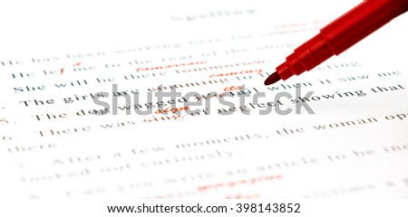 red pen marked on wrong spelling and write correct word above - stock photo