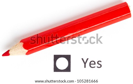Red pencil choosing between yes or no (voting) - stock photo