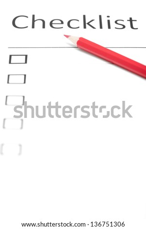 Red pencil on a daily plan. Vertical photo - stock photo