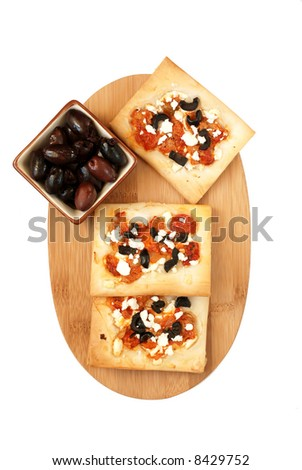 red pepper, artichoke, olive and goat cheese tarts - isolated on white background - stock photo