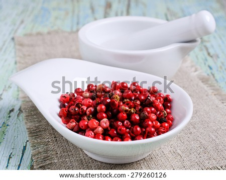 Red pepper in a ceramic dish on the sacking - stock photo