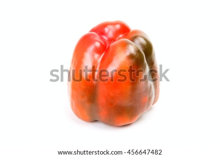 Red pepper with green dots isolated on white background - stock photo