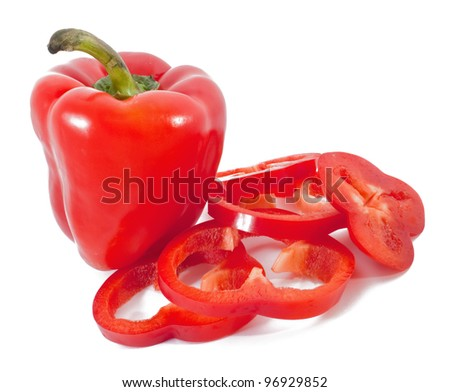 Red pepper with slices on white - stock photo