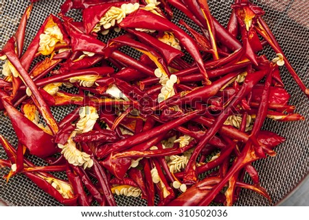 Red peppers drying. - stock photo