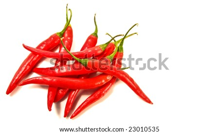 Red peppers laying against a white background