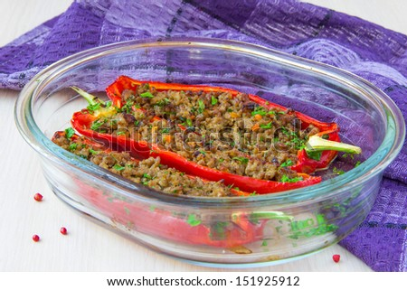 Red peppers stuffed meat beef with parsley, delicious homemade food - stock photo