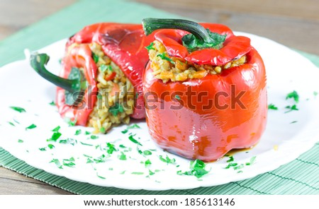 Red peppers stuffed with meat and rice - stock photo