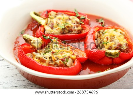 Red peppers stuffed with meat, rice and vegetables - stock photo