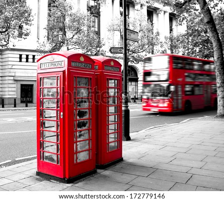 red phone booth and red bus in motion. London - stock photo