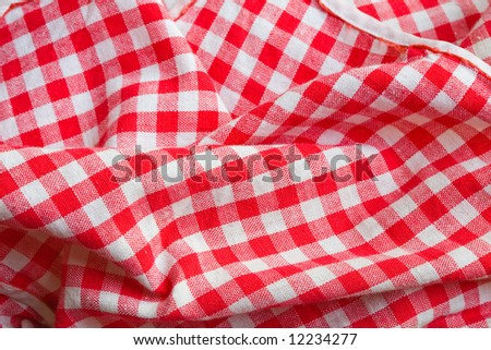 Red picnic cloth background. Texture detail closeup - stock photo