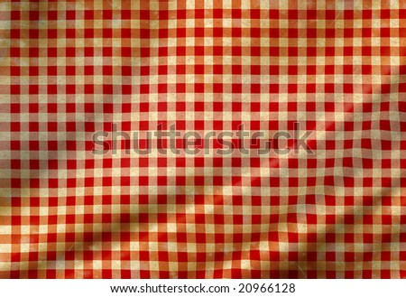 red picnic cloth with some smooth folds in it - stock photo