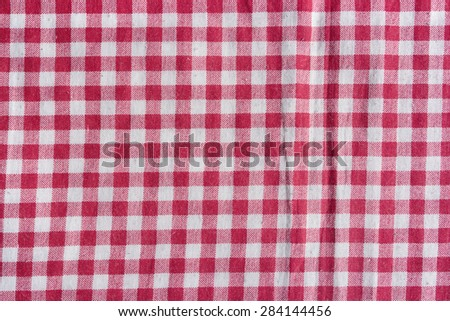 Red picnic tablecloth background. Red and white fabric texture.