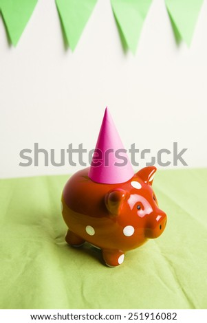 Red piggy bank having a party - stock photo