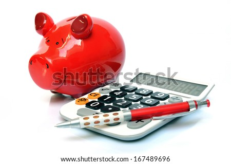Red piggy bank with calculator and ball pen - stock photo