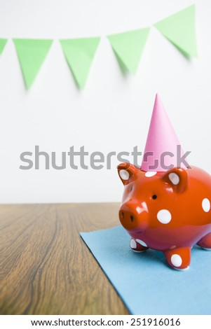 Red piggy bank with party hat - stock photo