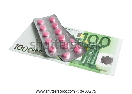 Red pills and 100 euro isolated on white - stock photo