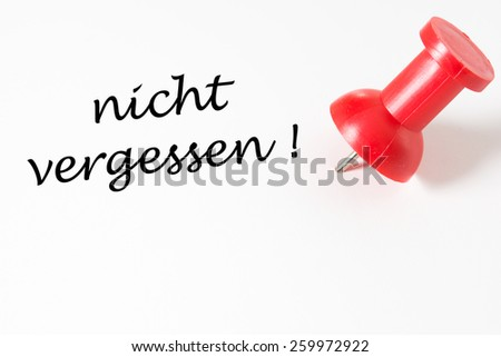 red pin needle and the german words do not forget / memory - stock photo