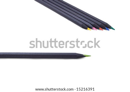 Red, pink, yellow, green and blue pencils made of black wood
