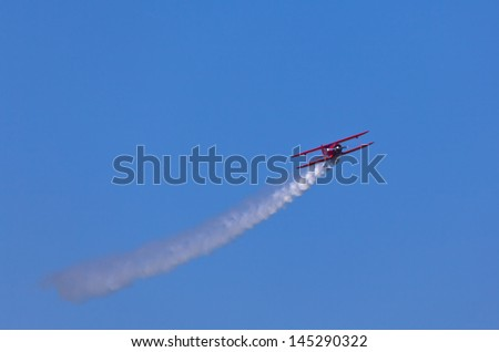 Red plane on blue sky