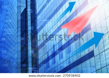 Red plane paper with arrow head and financial chart on tower city, target and win concept - stock photo