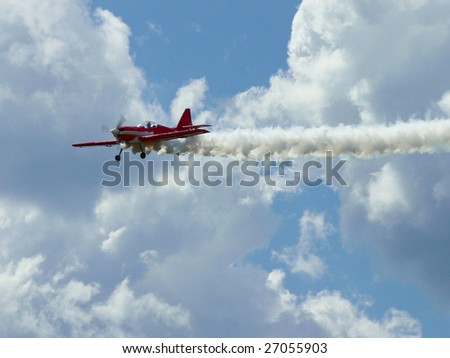 Red plane with white cloud's - stock photo