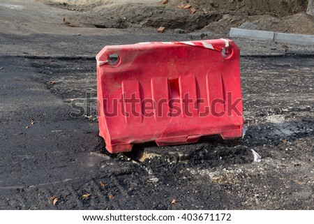 Red plastic fence with road repairs. Industry - stock photo