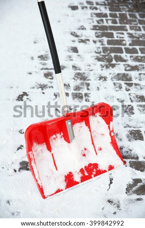 Red plastic shovel for snow - stock photo