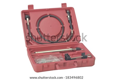 Red plastic tool box open on white background. - stock photo