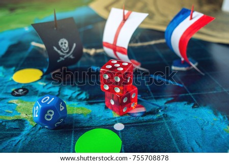 Red playing bones on world map stock photo 755708878 shutterstock red playing bones on the world map of the field handmade board games with a pirate gumiabroncs Choice Image