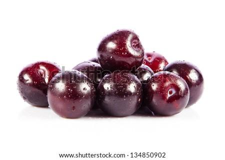 Red plum fruit isolated on white background. Fresh ripe washed plums - stock photo