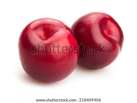 red plums isolated - stock photo