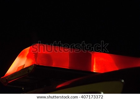 Red Police siren beacon light flashing on car - stock photo