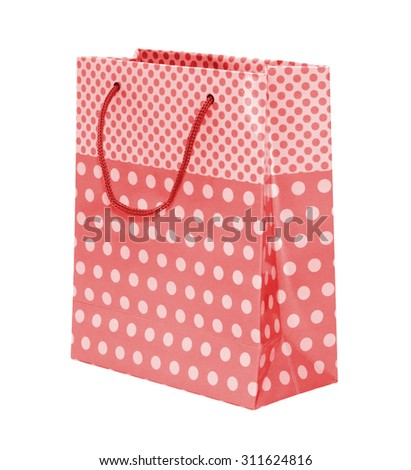 Red polka dots paper bag on white background.