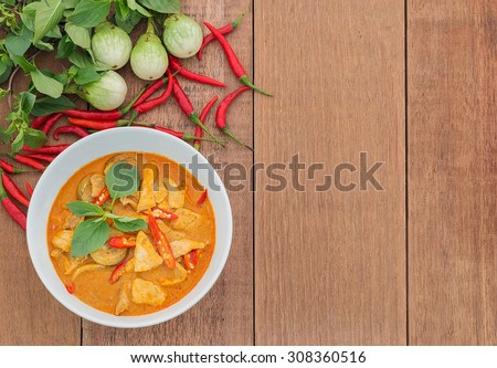 Red pork curry (Panang) with vegetable on wooden background, Thai food - stock photo
