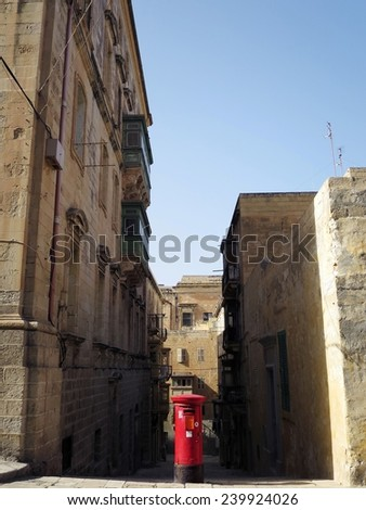 Red postbox in the Valletta historical center, Valletta, MALTA - stock photo