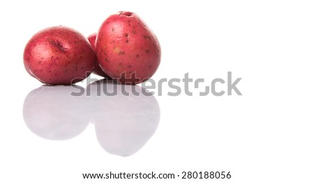 Red potato over white background - stock photo