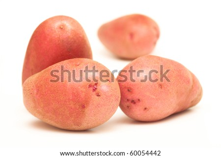Red potatoes on a white background - stock photo