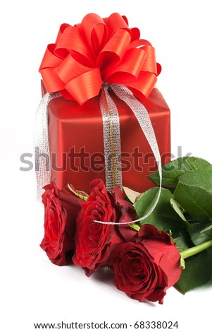 red present box and three roses