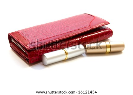 red purse and lipsticks on white
