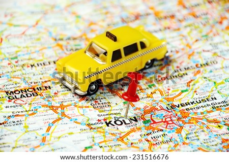 Red push pin pointing at Coln,Germany  map   and a taxi - stock photo