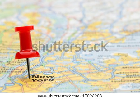 Red pushpin marking the location of New York City on a road map, selective focus - stock photo