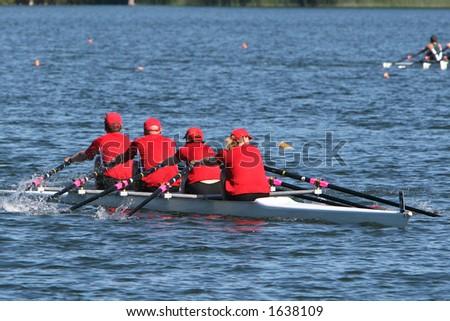 Red quad rowboat - stock photo