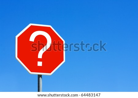 Red question mark sign against a blue sky - stock photo