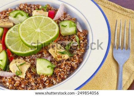 Red Quinoa Tabbouleh salad with juicy grilled chicken and cucumbers with chopped parsley - stock photo