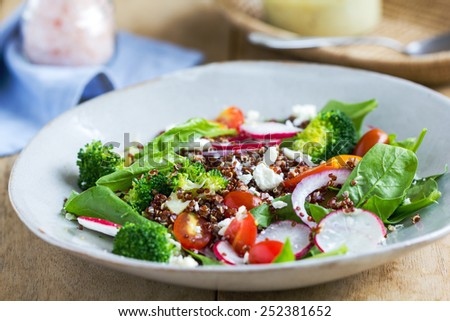 Red Quinoa with spinach and feta cheese salad by tahini dressing - stock photo