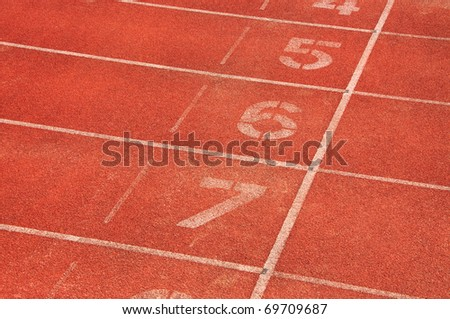 Red race track with lane numbers - stock photo