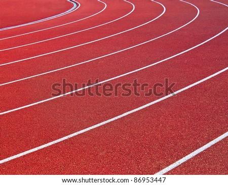 Red racetrack on the stadium - stock photo